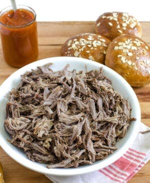 How to make just about any kind of pulled meat in the slow cooker (beef, pork, lamb, elk) to create the most delicious shredded meat for any recipe.