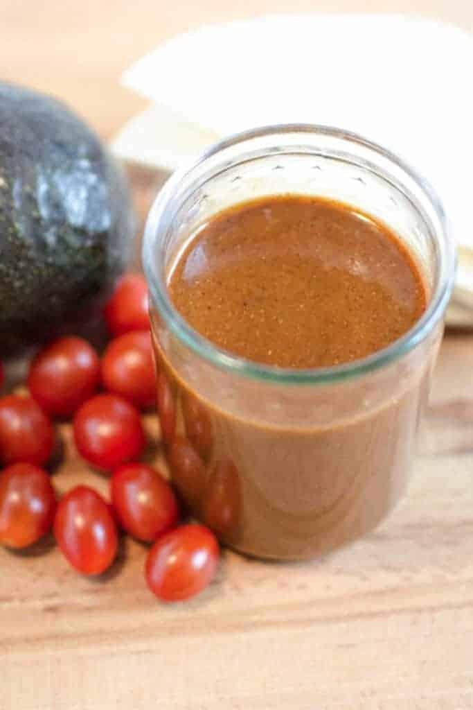A jar of homemade red enchilada sauce