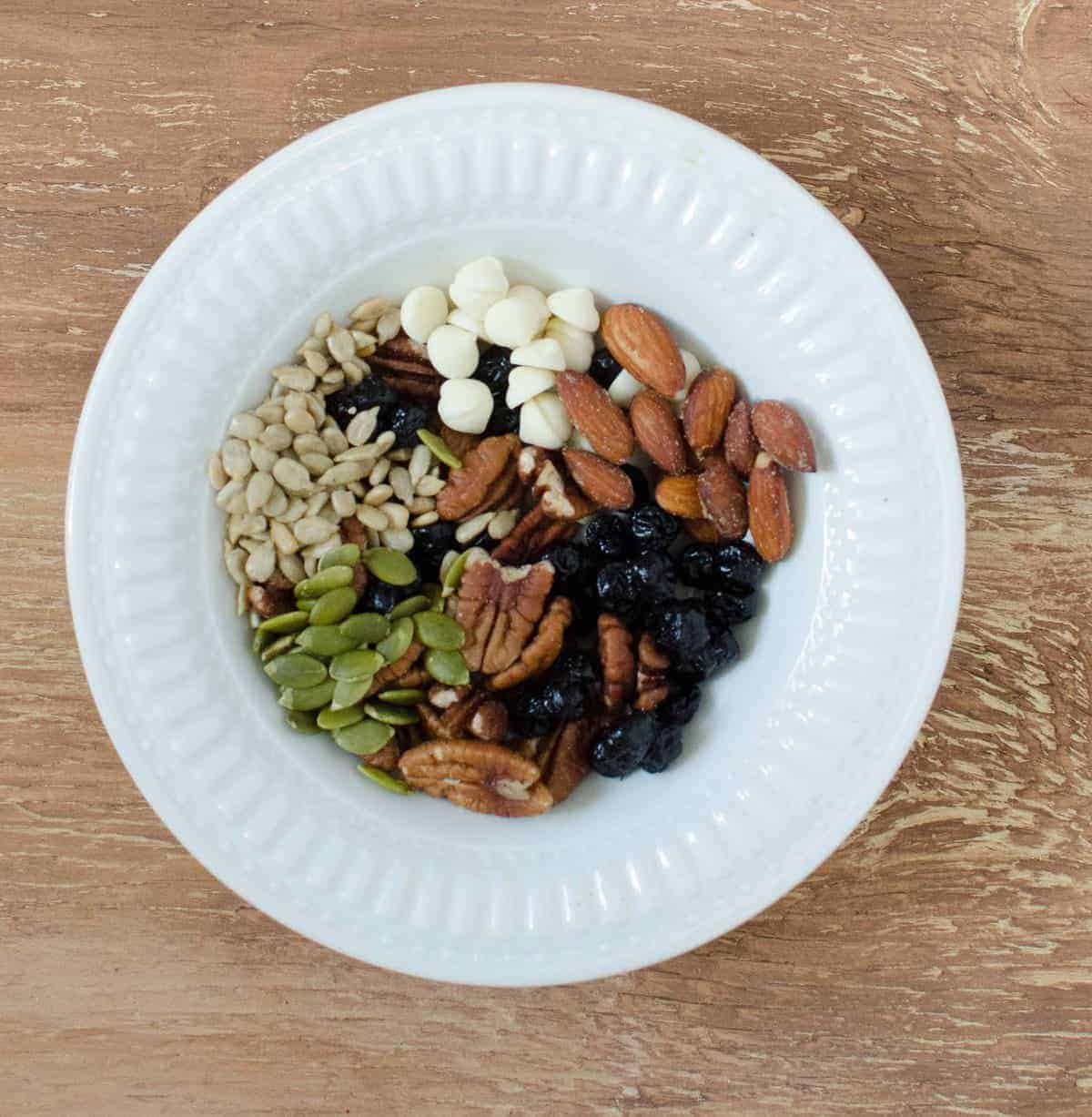 Trail Mix - Dried blueberries, salted almonds, pecans, pumpkin seeds, sunflower seeds, and white chocolate chips.