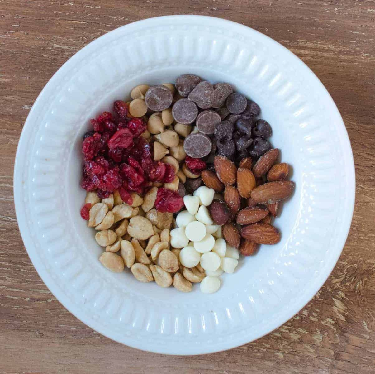 Trail Mix - Peanuts, salted almonds, dried cranberries, milk, semi-sweet, white, AND peanut butter chips.