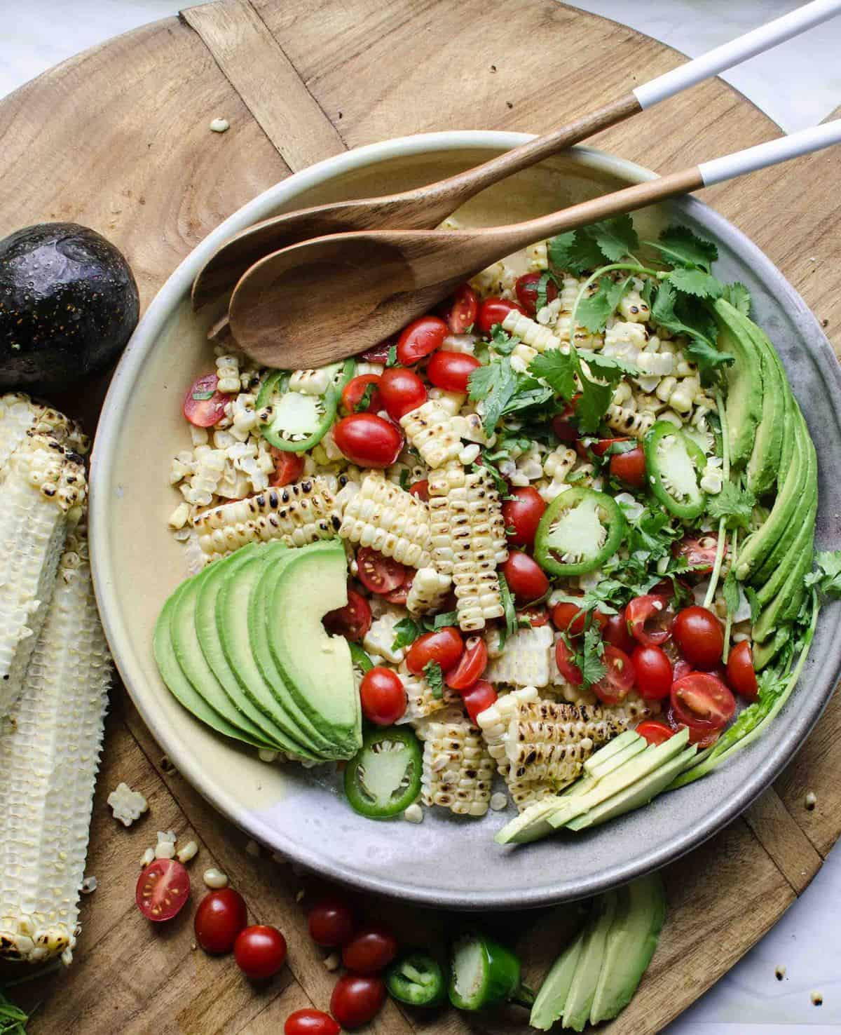 Grilled Corn & Avocado Salad is the perfect simple side to serve all summer long! It comes together in a snap, & is made of delicious seasonal ingredients.