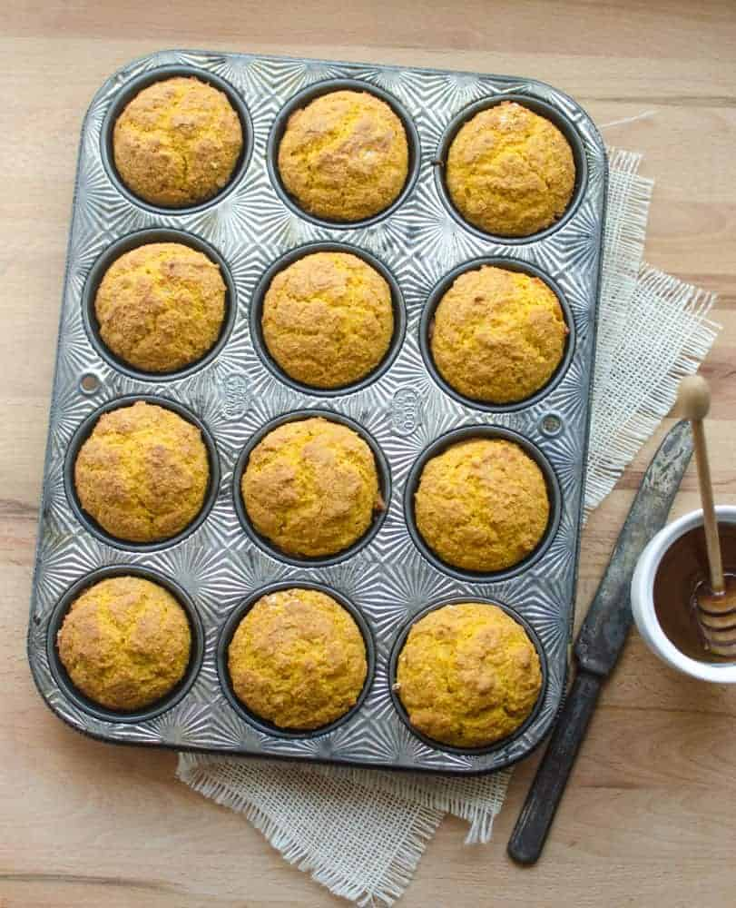 Image of Pumpkin Cornbread Muffins in a Muffin Tin