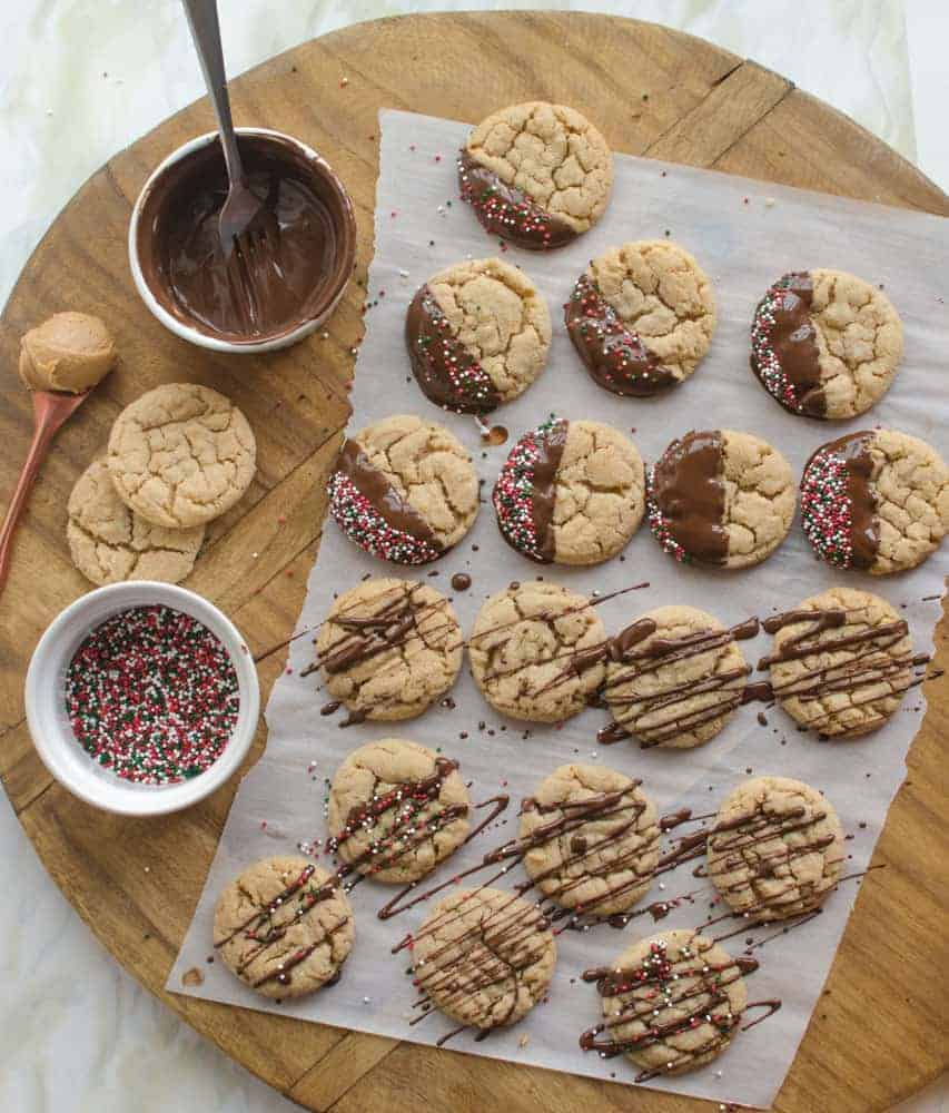 A dip in chocolate and some festive sprinkles turn year-round favorite peanut butter cookies into a delicious Christmas treat.