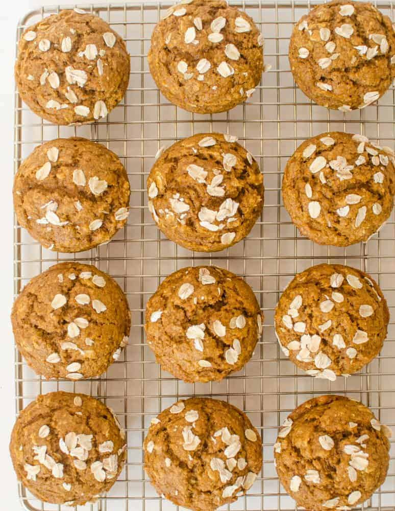 Healthy Pumpkin Muffins made with oats, real maple syrup and whole wheat flour are perfect for breakfast, snacks, or a dinner side!