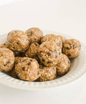 Easy, no-bake energy ball recipe perfect for snacks, lunch boxes & post-workout recovery. Tasty bites made with peanut butter, chocolate chips & oatmeal!
