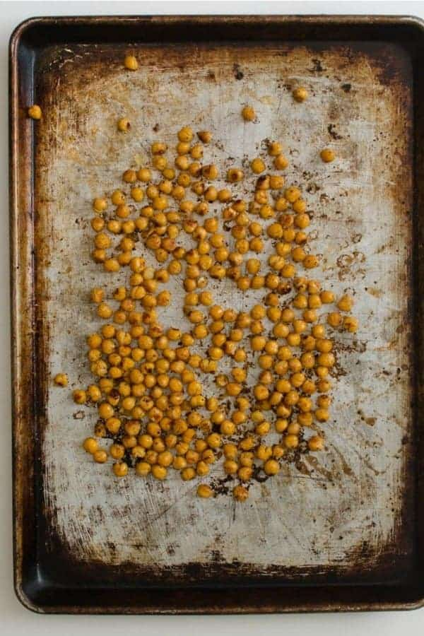 Top view of roasted chickpeas on a baking sheet