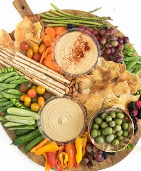 A Simple DIY Hummus Platter is a beautiful addition to any party, or it can be a meal all on its own! And it couldn't be easier to make!