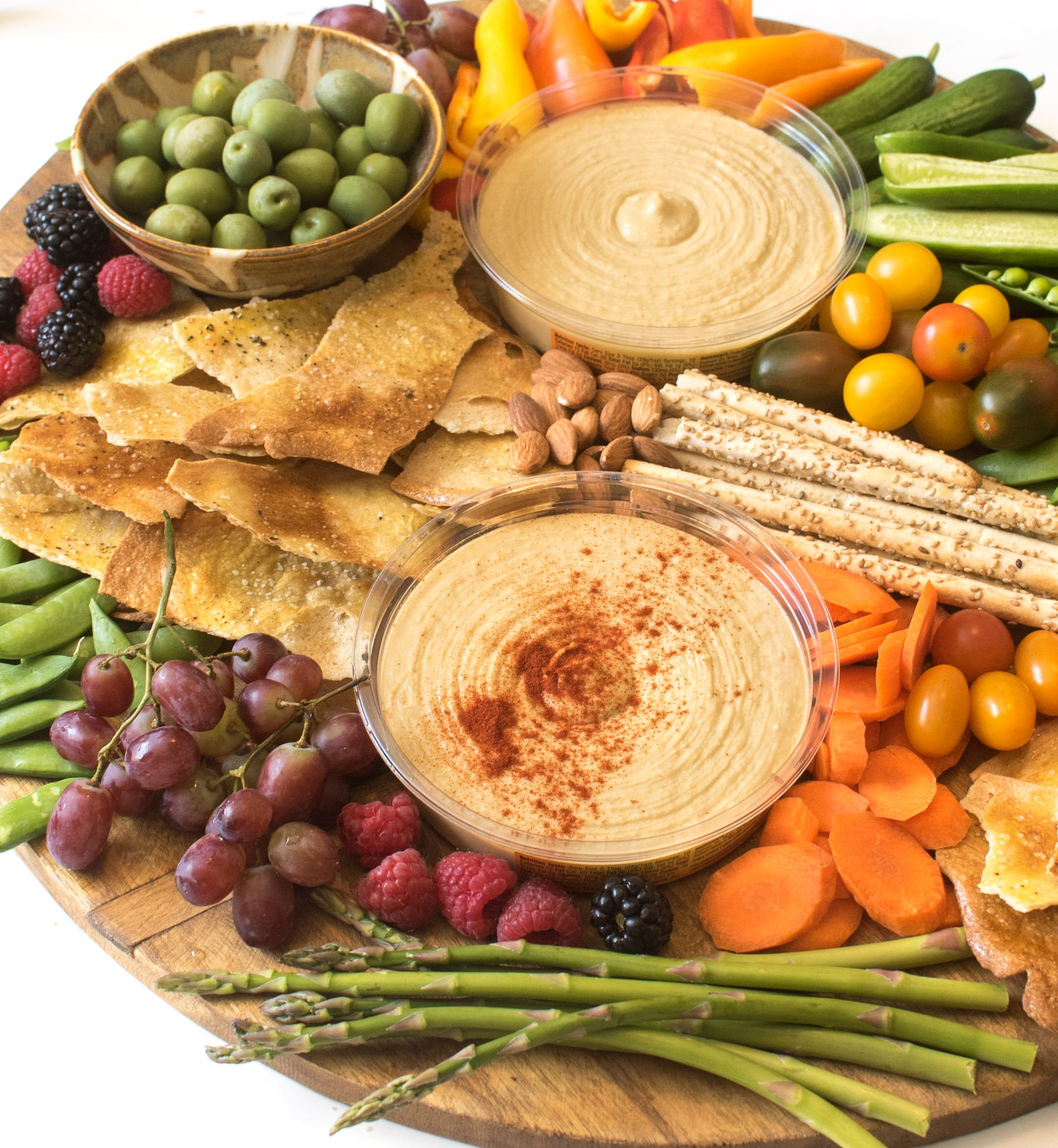 A simple DIY hummus platter is a beautiful addition to any party, or it can be a meal all on it's own!