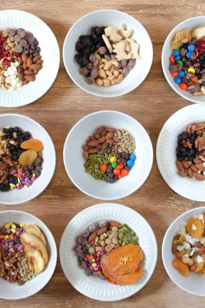 9 bowls of different varieties of homemade trail mix