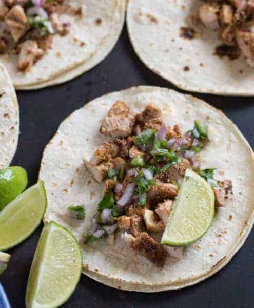 Introducing the Best Chicken Tacos Ever. An easy chicken taco recipe made with chicken thighs, plus a simple onion & cilantro topping. This is our all-time favorite chicken taco recipe. They taste like they just came off a food truck!