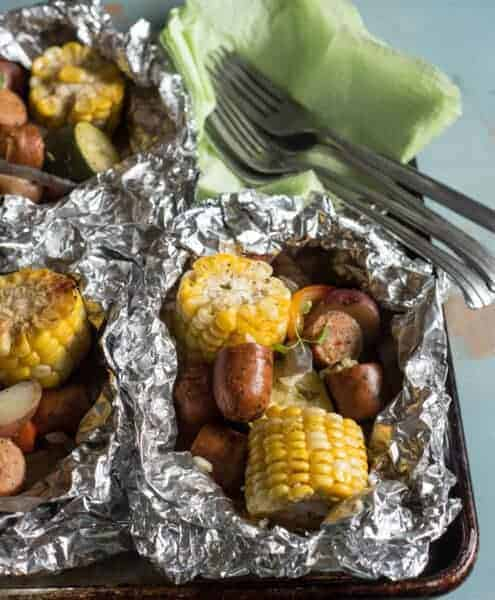 Image of grilled sausage and vegetable foil packets