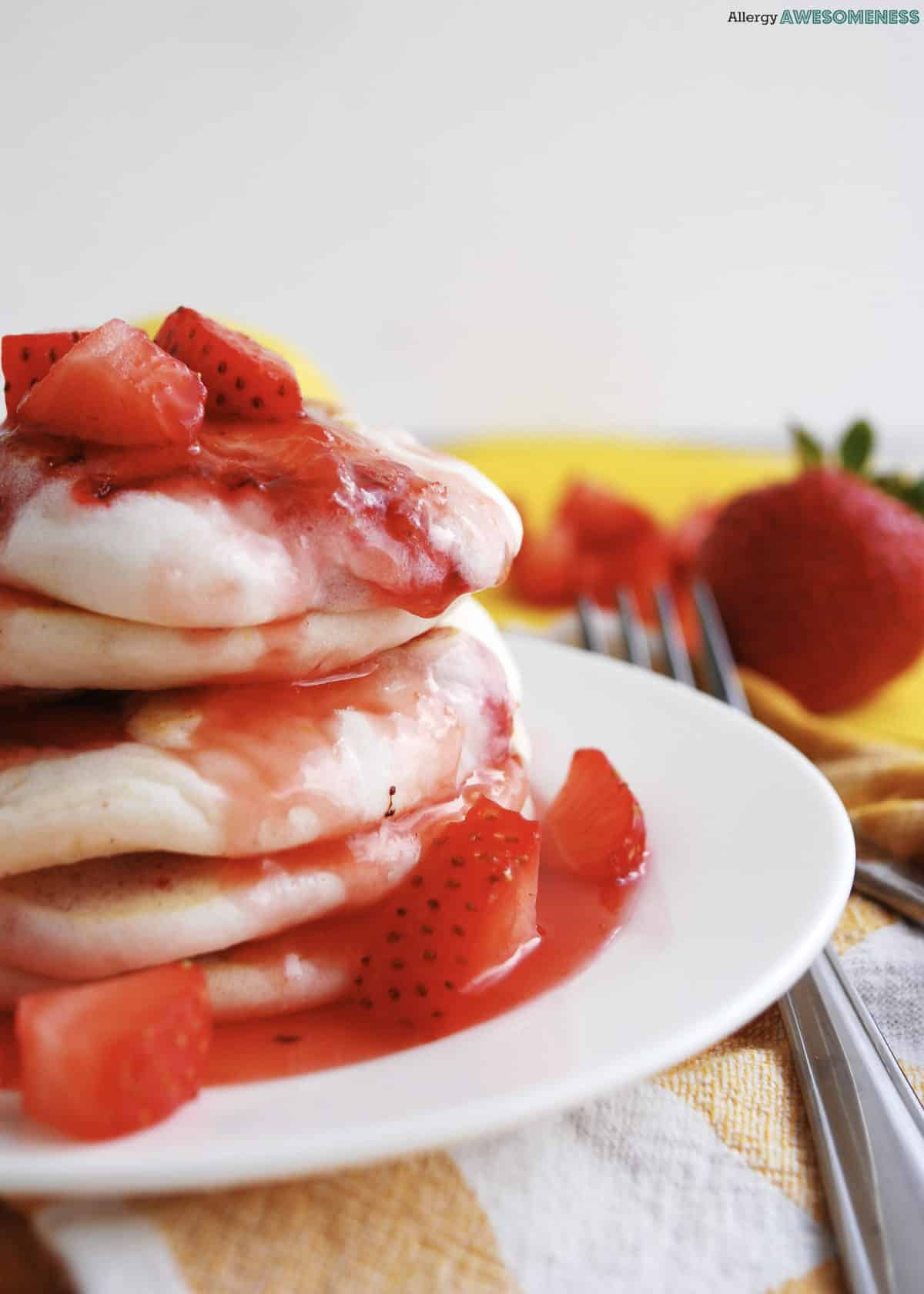 Soft, fluffy strawberry pancakes drizzled with homemade strawberry syrup; they are allergy friendly, free of: gluten, dairy, egg, soy, peanut and tree nuts.