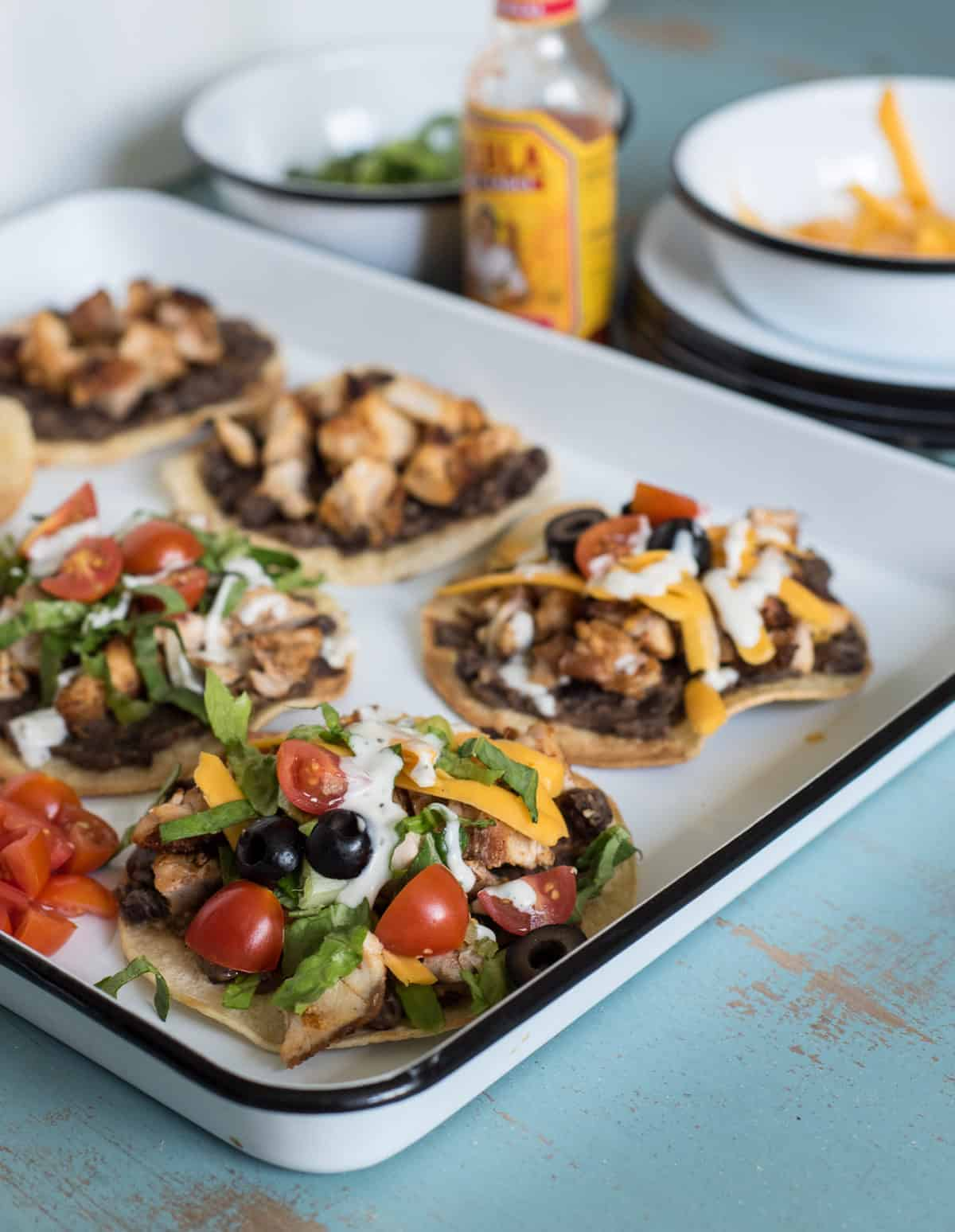 The Best Chicken Tostada Recipe takes 30 minutes to make, includes simple baked tostada shells, and the whole family will love it.