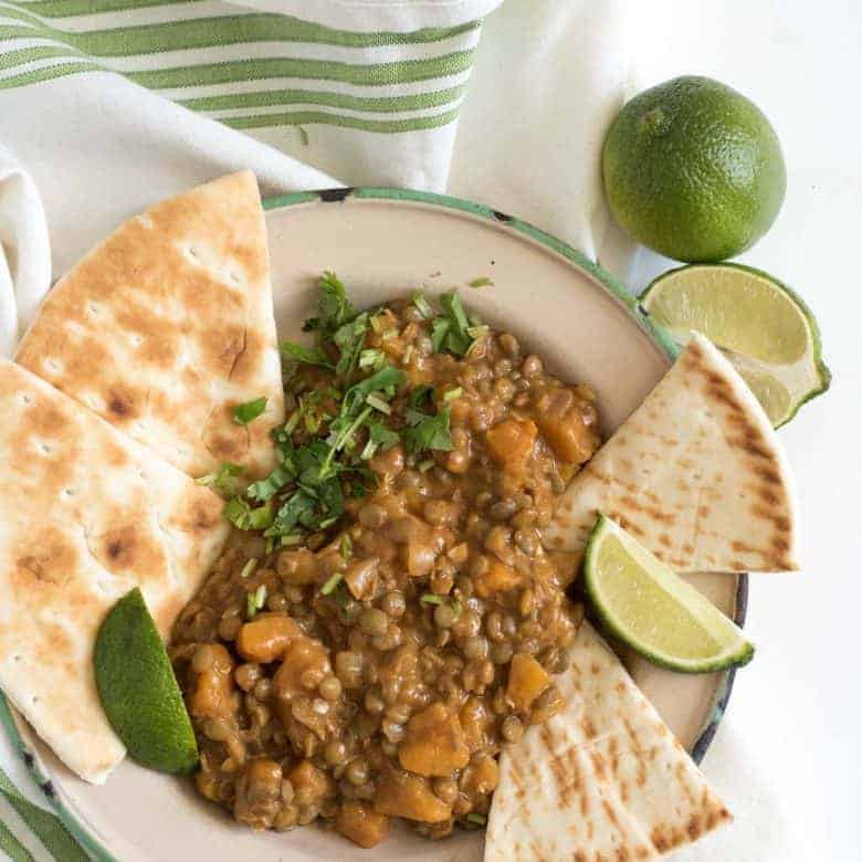 This simple lentil curry is one of my favorite butternut squash recipes! Made with coconut milk, it's a perfect & healthy vegetarian family dinner recipe.