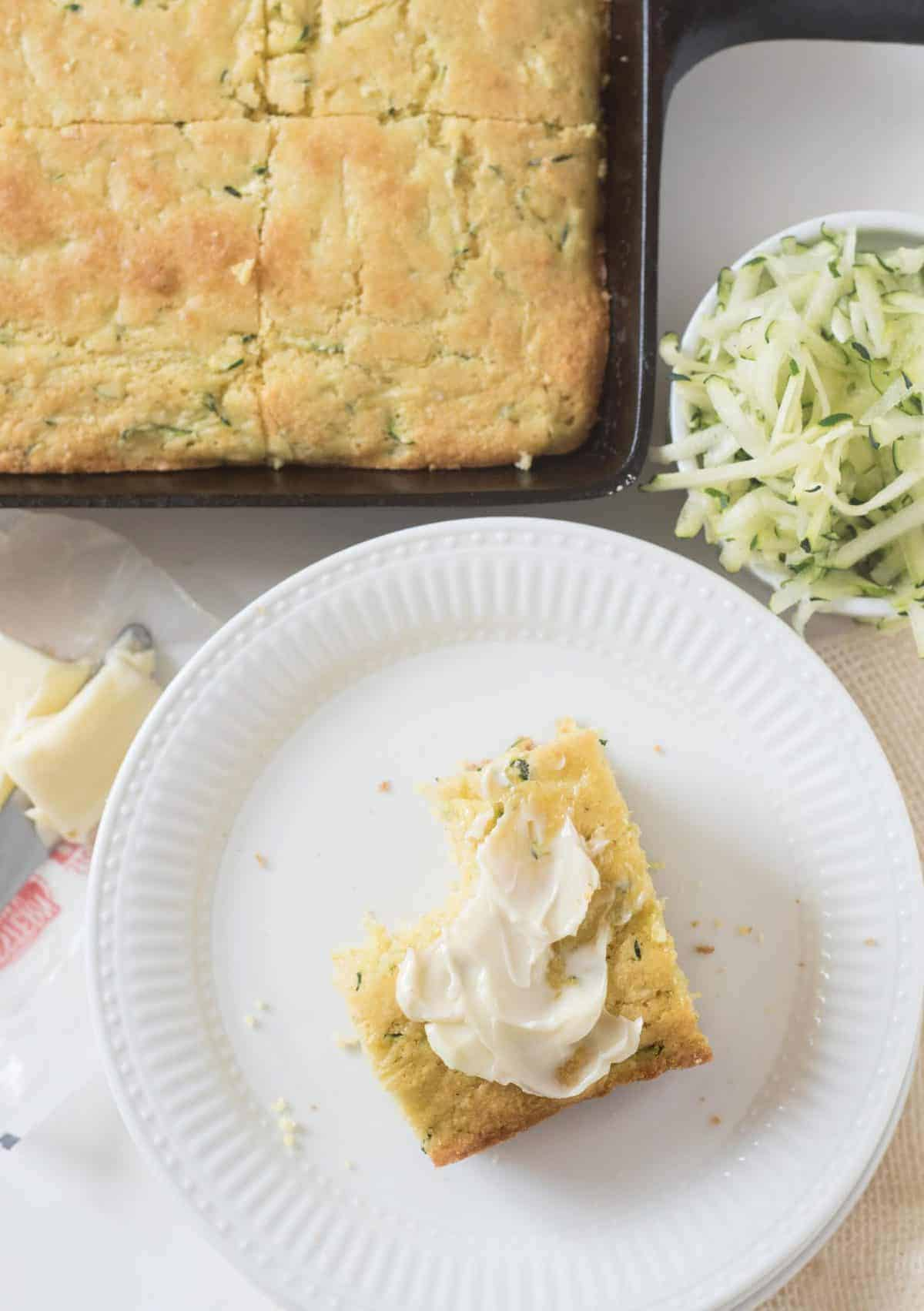 Light and fluffy zucchini cornbread that is sweet and moist thanks to the addition of grated zucchini, on the table in around 30 minutes!