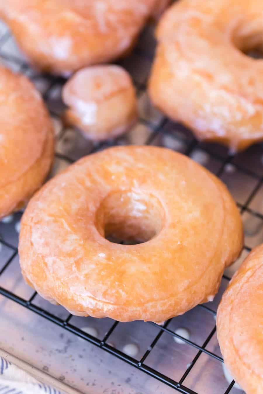 Glazed donuts on a rack