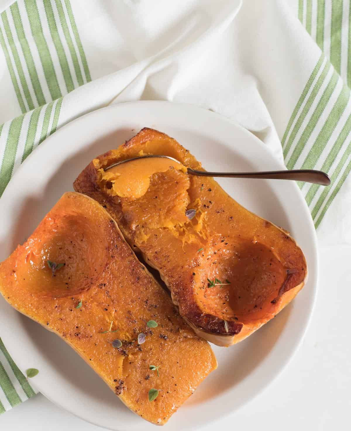 Quick and easy guide on how to roast butternut squash in the oven. You can use the roasted as a side dish or in recipes that call for pumpkin puree!