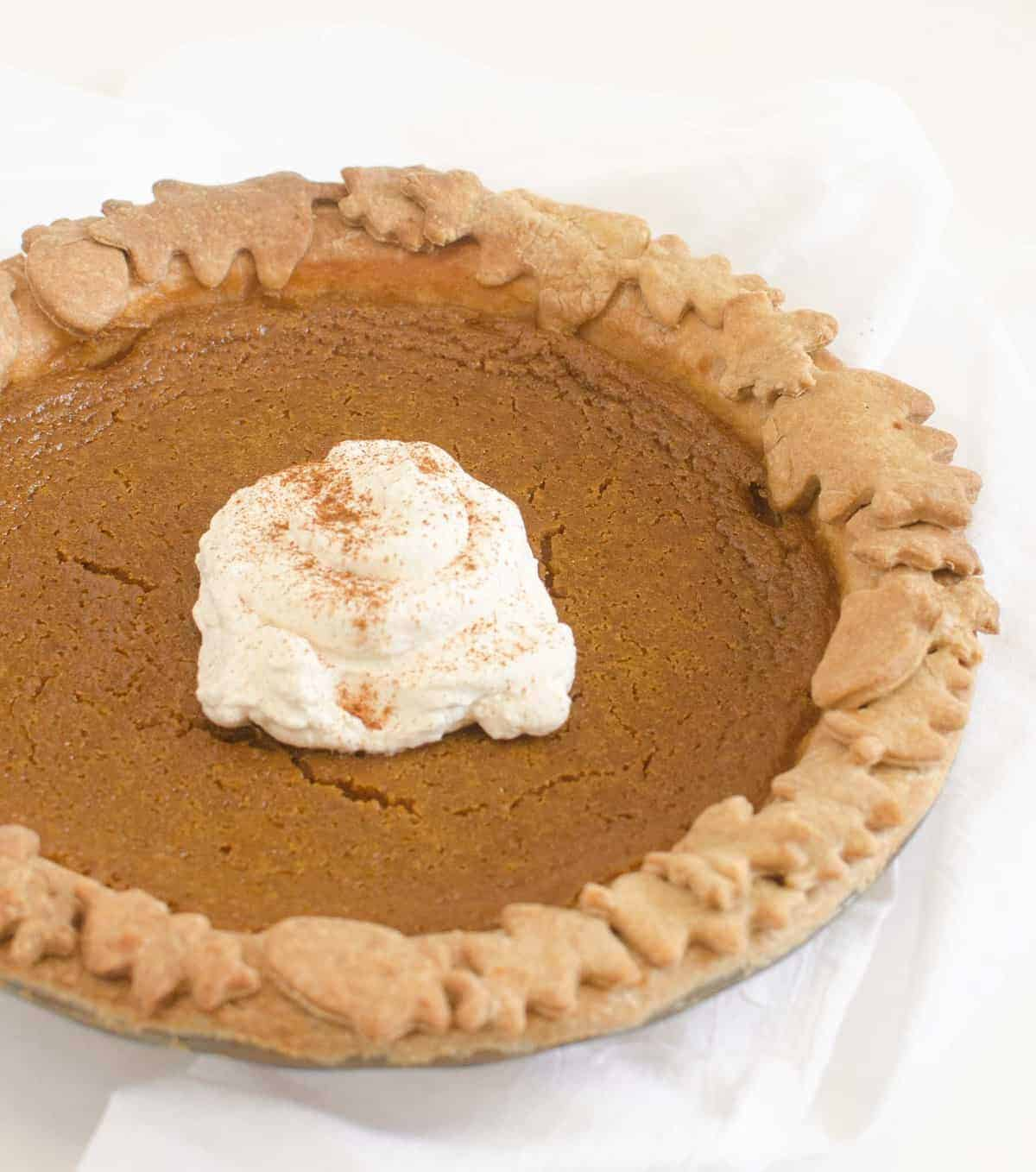 Healthy pumpkin pie recipe in a whole wheat crust sweetened with real cream and maple syrup. One of my favorite whole food pie desserts!