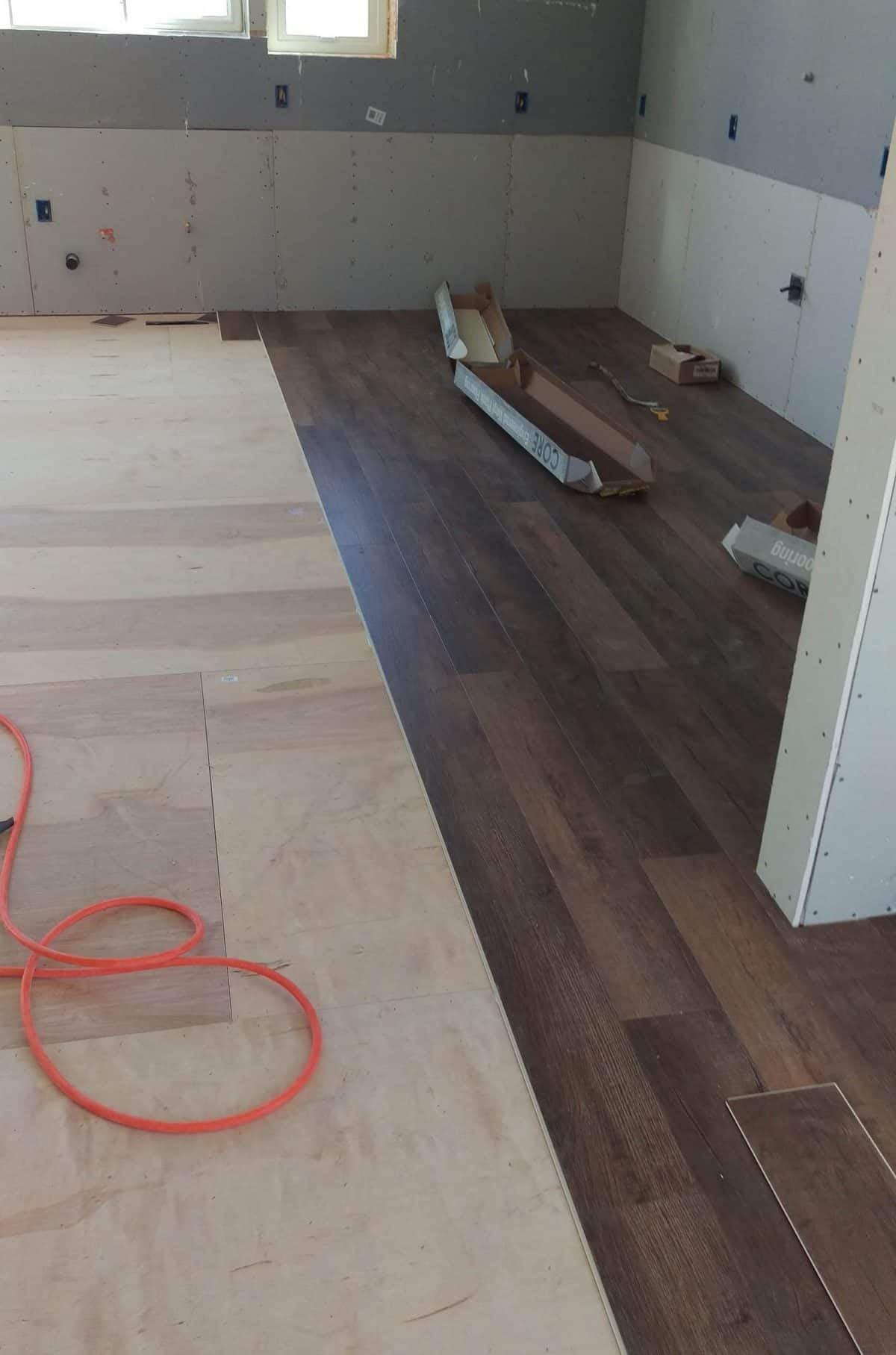 a look at the dark wood floors being installed