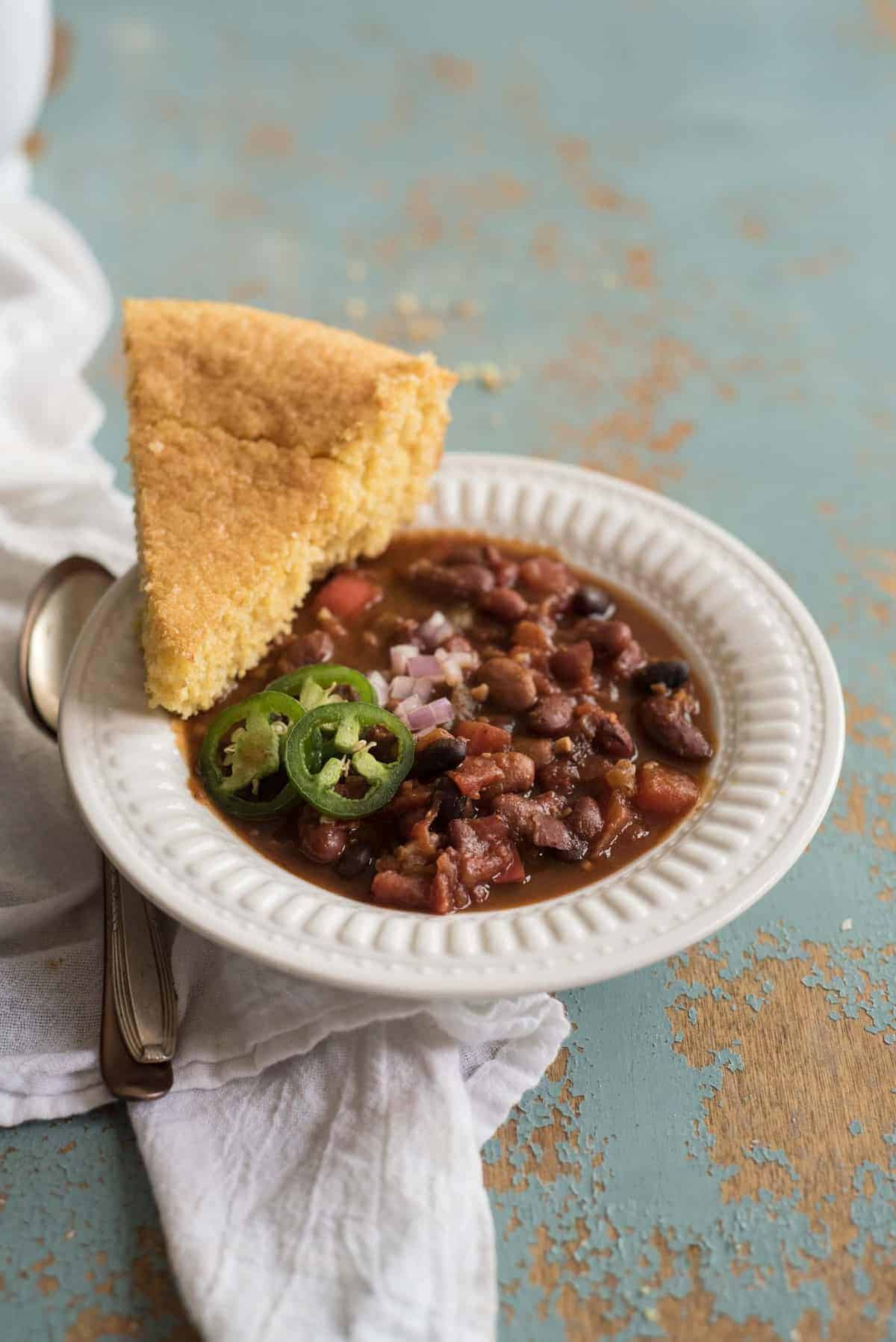 Healthy and flavorful Instant Pot Vegetarian Chili recipe made with a mix of dried beans, vegetables, spices, and a secret ingredient. A healthy, one-pot meatless meal your whole family will love.