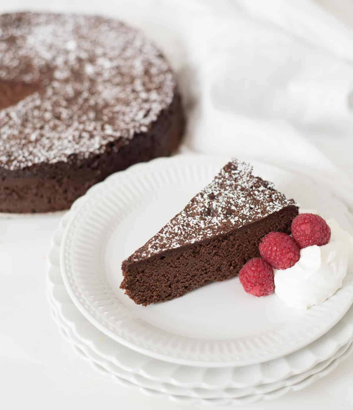 Light and fluffy flourless chocolate torte recipe made from just three simple ingredients. You won't believe how delicious this flourless chocolate torte is.