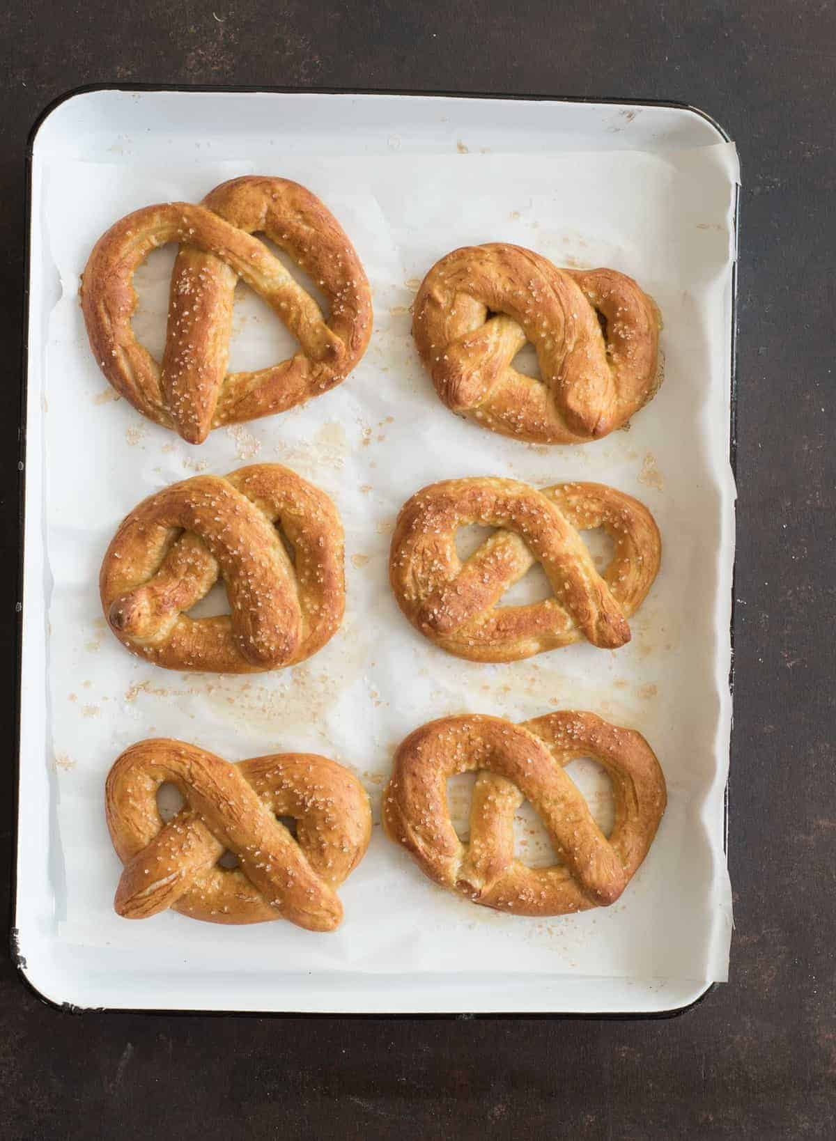 Big soft pretzels made from a simple dough, boiled, and then baked to golden perfection are one of our all time favorite salty and chewy treats.