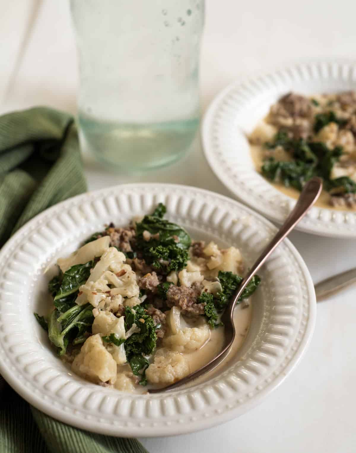 Healthy Cauliflower Sausage and Kale soup is the low carb version of Zuppa Toscana that uses cauliflower in place of the potatoes!