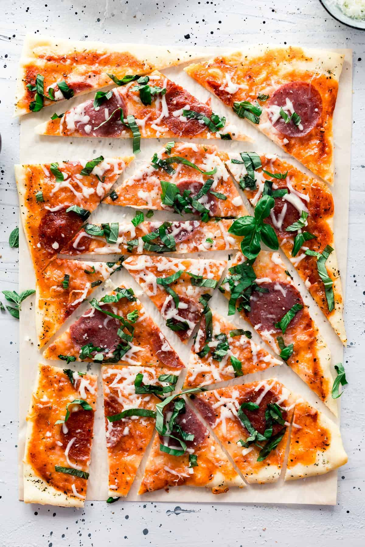 Meaty Margherita Pizza made with the traditional tomatoes, cheese, and basil but with added pepperoni and salami to make it one crowd pleasing pizza done in only 30 minutes.