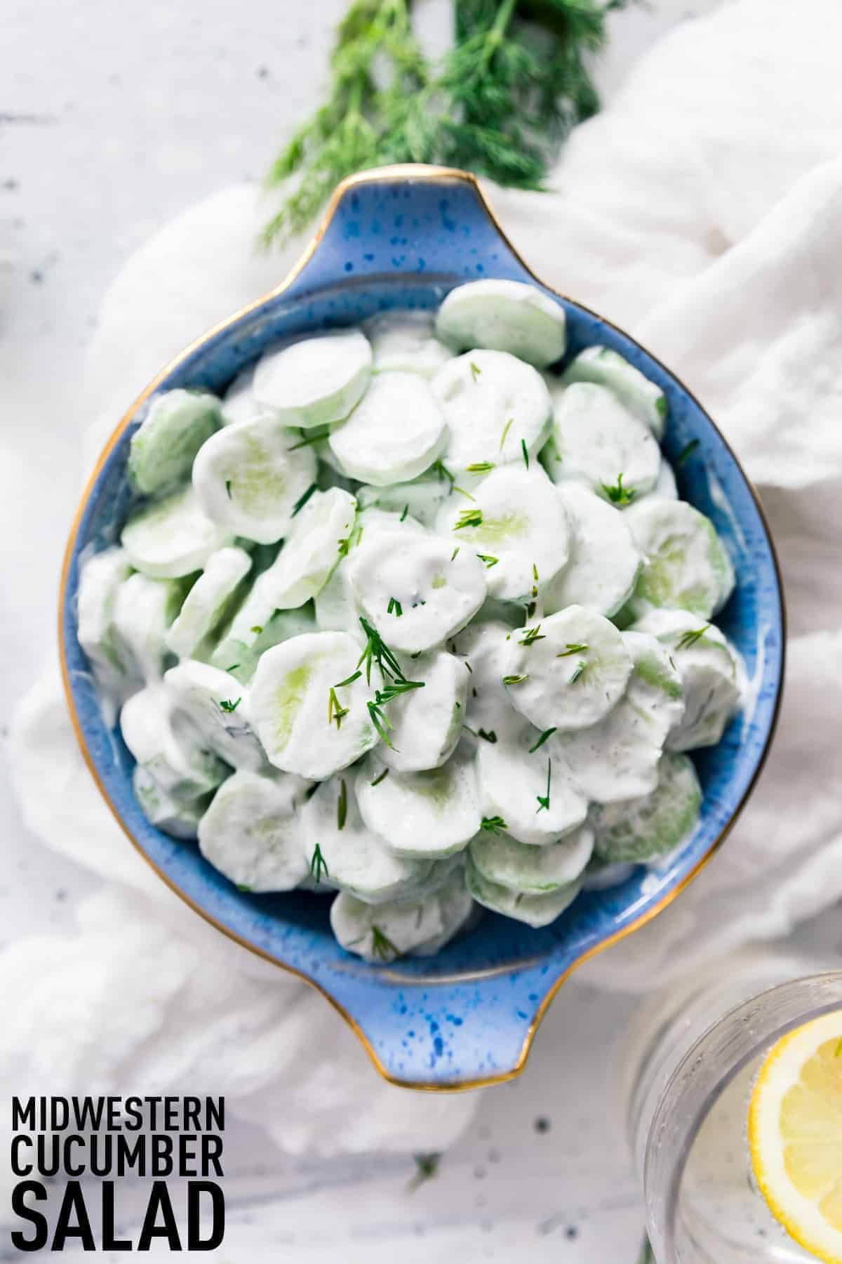 Midwestern Creamy Cucumber and Vinegar Salad made with fresh cucumbers, sour cream, vinegar, and fresh herbs, a summer stable for every picnic and cookout!