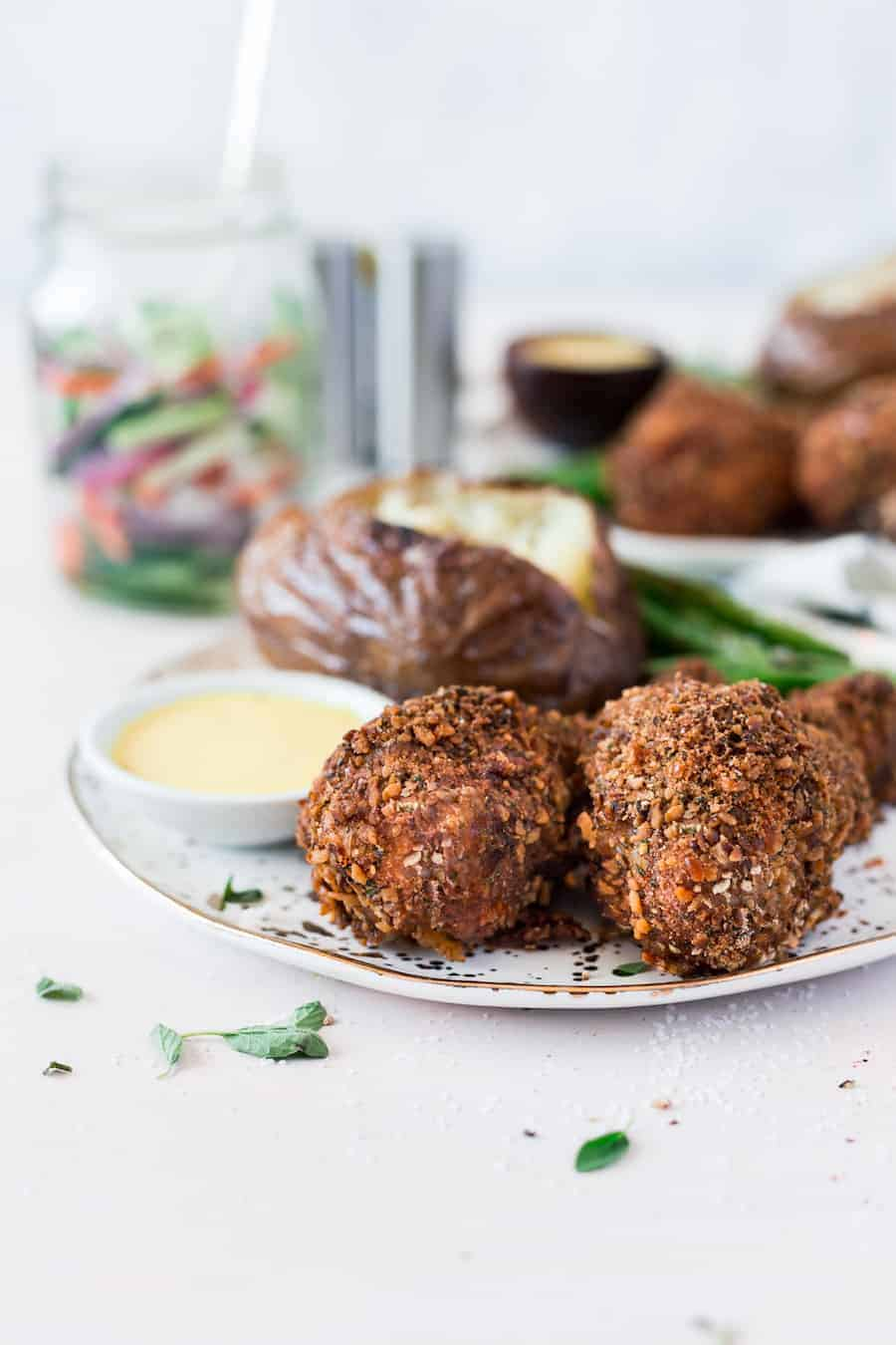 Crispy baked chicken drumsticks recipe made with a homemade pretzel coating that makes the crispiest chicken legs on the block! No frying needed! #chicken #dinner #chickenlegs