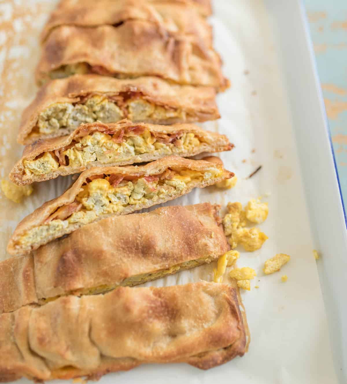 Quick and easy breakfast pizza sticks made with pizza dough, eggs, bacon, and cheese, all baked into easy to eat pizza sticks.