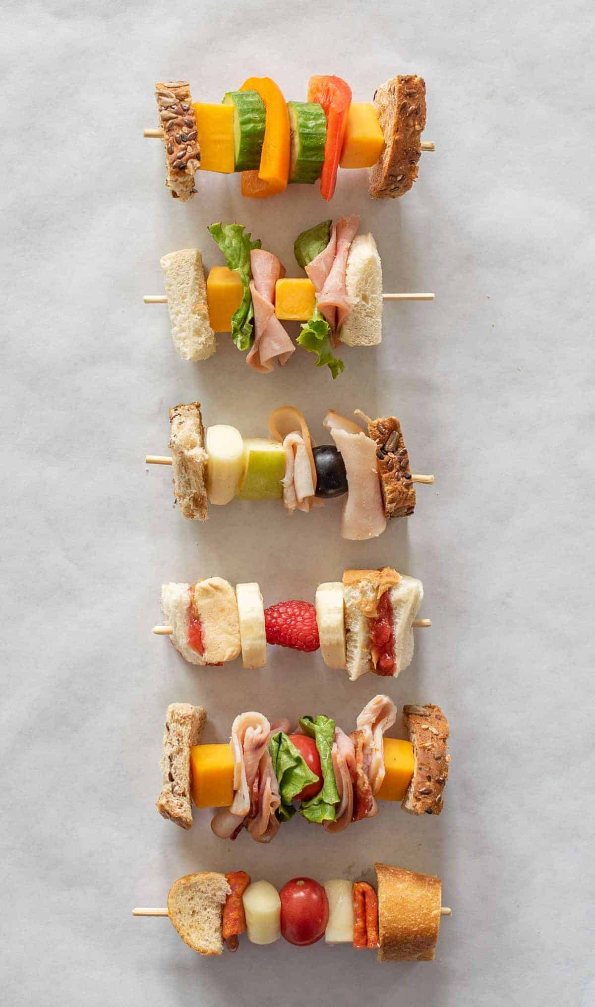 "6 Easy ""Sandwich-on-a-Stick"" Lunch Box Ideas are perfect to take to school or work and are a fun twist on all of your favorite classic sandwiches."