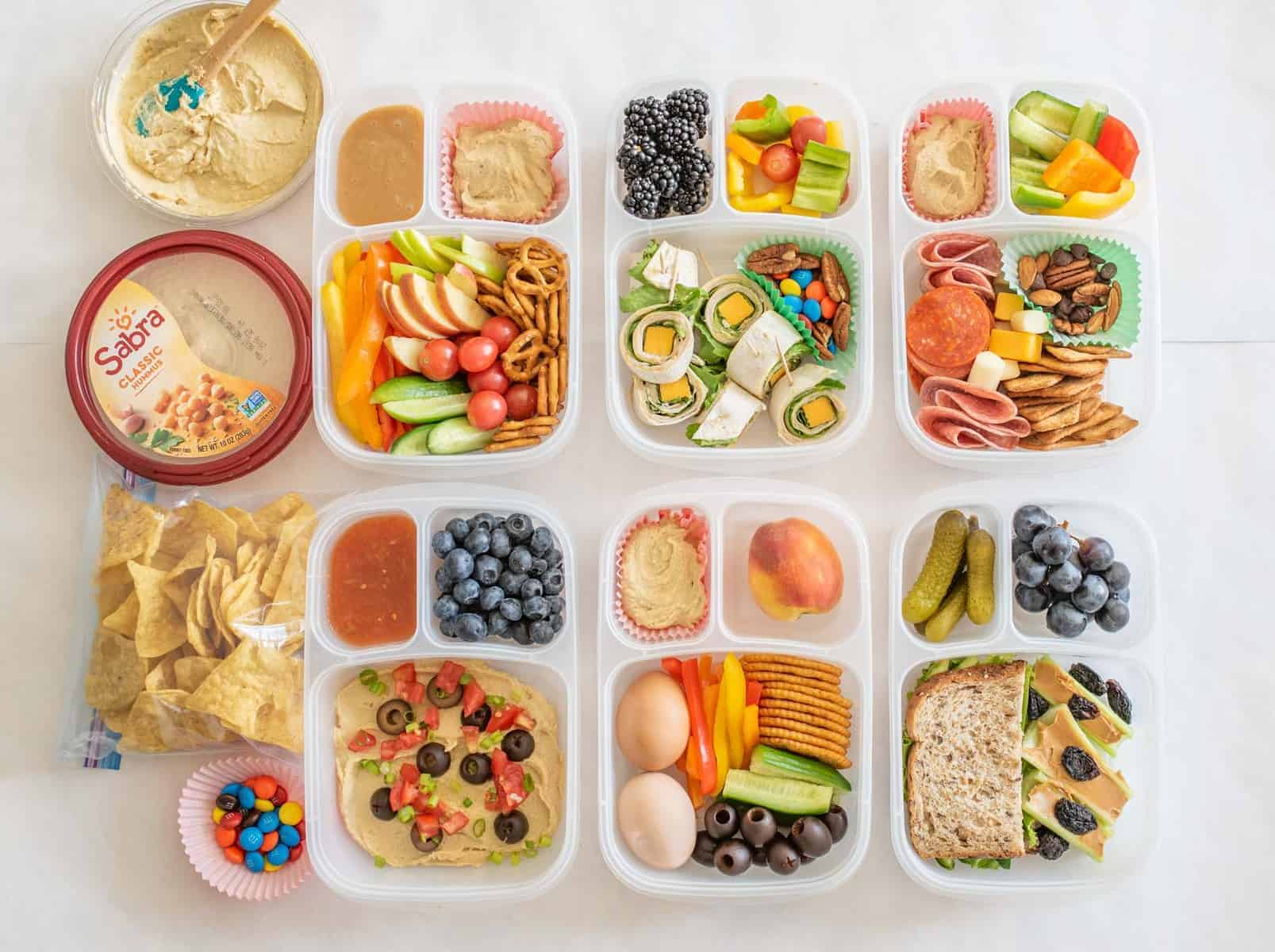 Six quick and easy school and adult lunch box ideas made with Sabra Hummus, fruit, vegetables, and more.