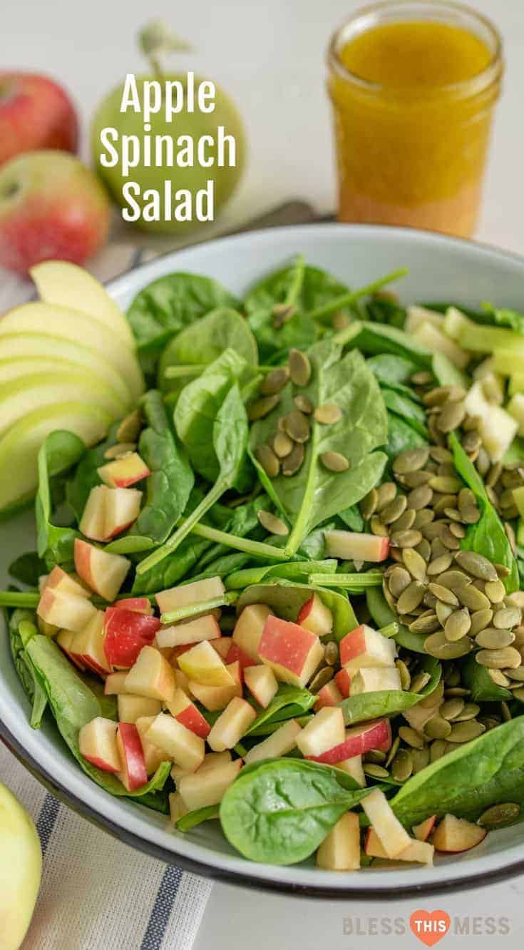 Quick and easy spinach salad recipe with apples, pumpkin seeds, and a simple flavor-filled apple vinaigrette dressing to go with it.