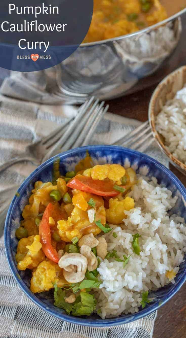 Quick & easy pumpkin cauliflower curry recipe made with canned pumpkin, coconut milk, curry paste & lots of vegetables for a healthy vegetarian dinner. #curry #dinner #meatless #vegetarian #vegan #pumpkin #cauliflower