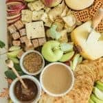 Top view of Easy Fall Apple and Cheese Board with a variety of crackers, cheeses, apples, and dips