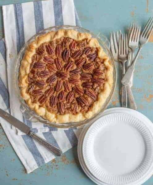 Image of a pecan pie with some plates