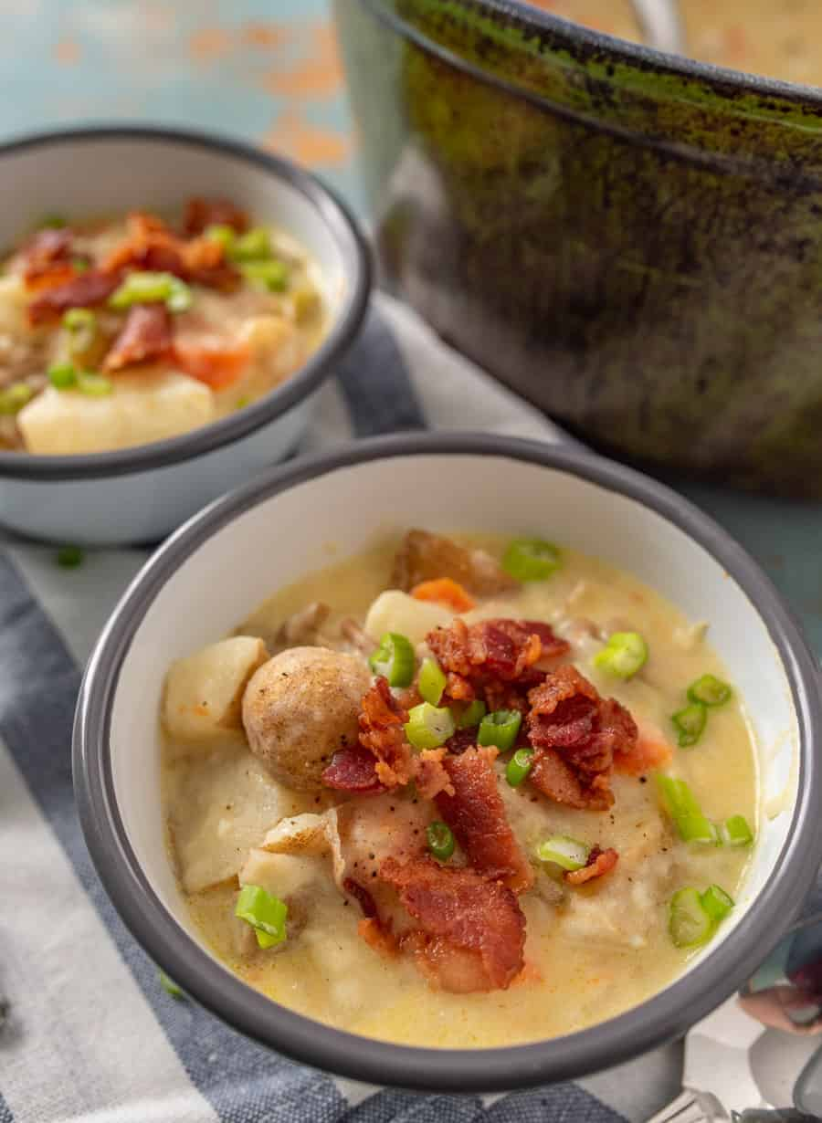 Classic creamy potato chowder with bacon, lots of veggies, potatoes, and made creamy with the addition of sour cream.