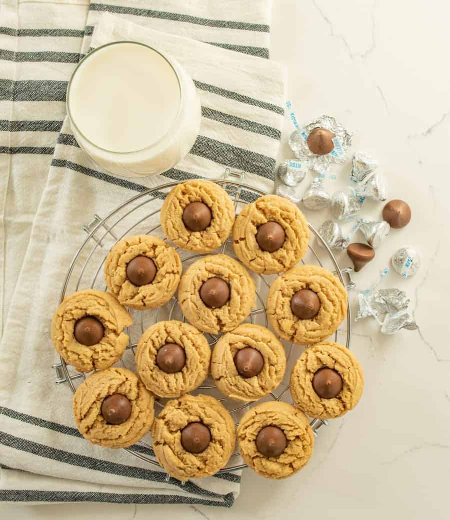 The best peanut butter blossoms made with a thick, soft, and chewy peanut butter cookies and a chocolate kisses pressed in the middle.