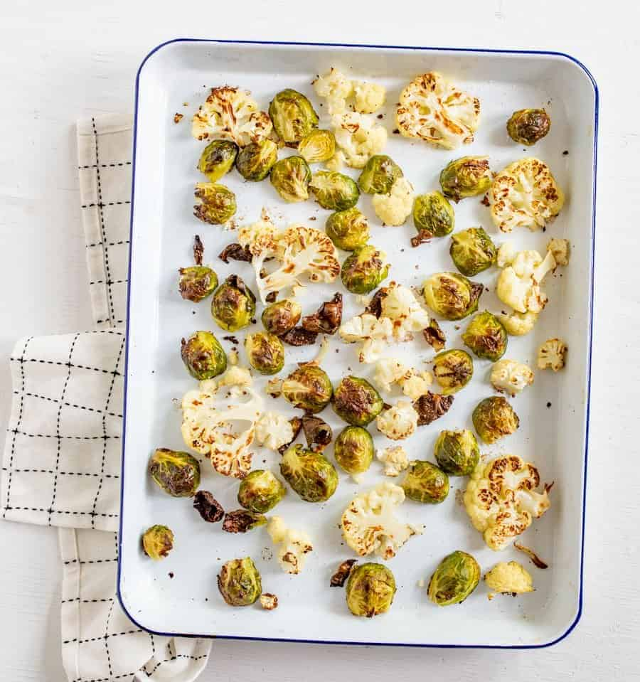 Roasted Brussels Sprouts and Cauliflower is one of our all-time favorite healthy vegetable side dishes that the whole family loves to eat.