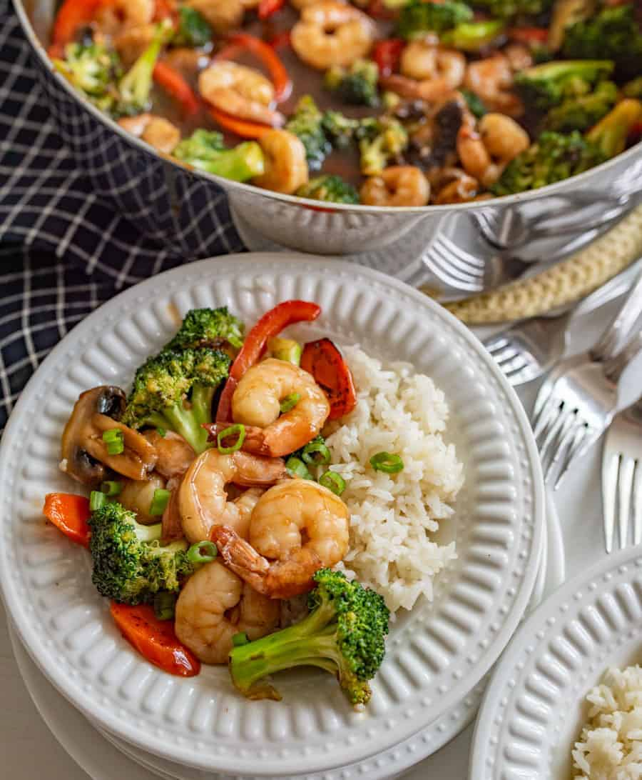 Quick easy and healthy shrimp stir fry that is made with lots of vegetables, shrimp, and a simple homemade sauce in 30 minutes or less.