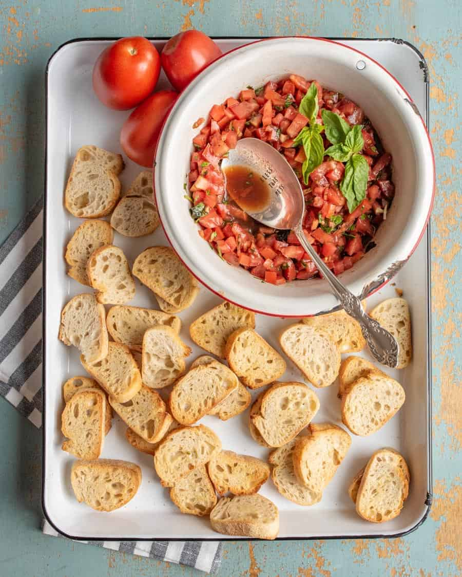A simple and fresh appetizer, Summer Tomato Bruschetta brings lively flavors of tomato and basil to crunchy, well-buttered slices of toasted baguette.