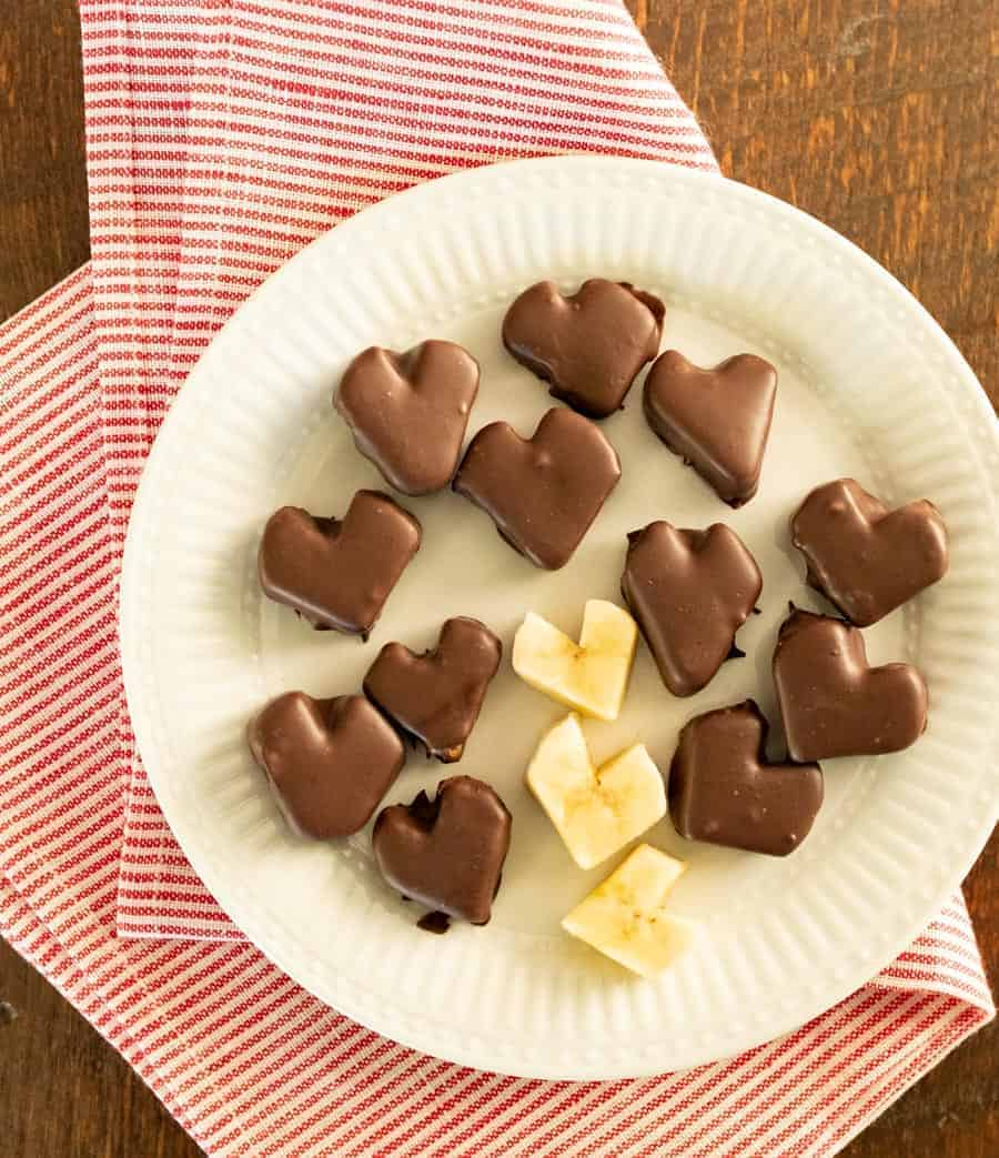 Chocolate covered banana hearts made with only two ingredients and are a great treats for kids to help make and eat.