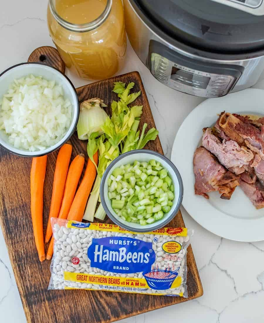 Classic Ham and Bean Soup made in the Instant Pot with ham, dry great northern beans, vegetables, and a few other simple ingredients and cooked in about an hour thanks to use a pressure cooker.