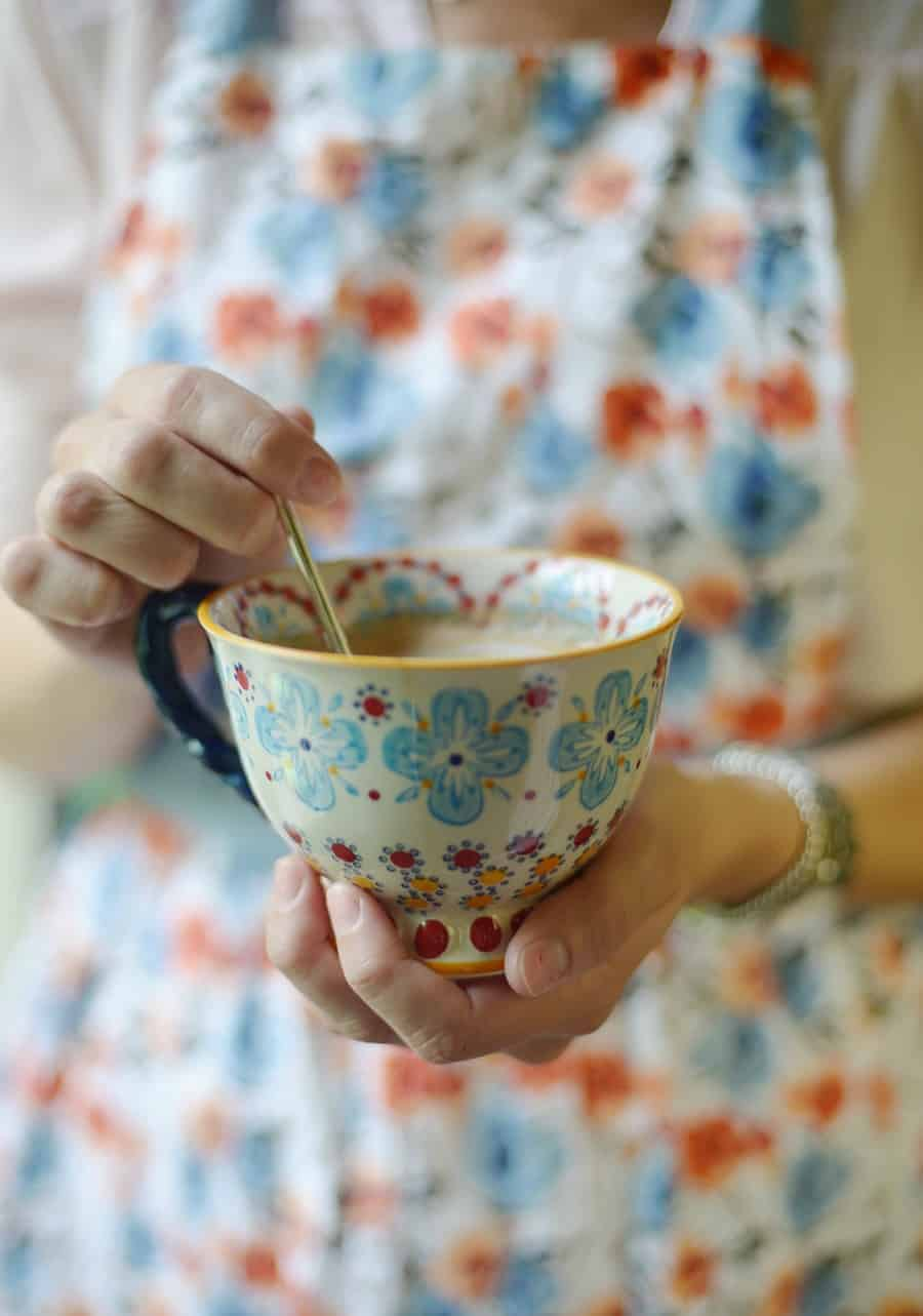 Natural remedies for anxiety including herbal chamomile tea in floral mug