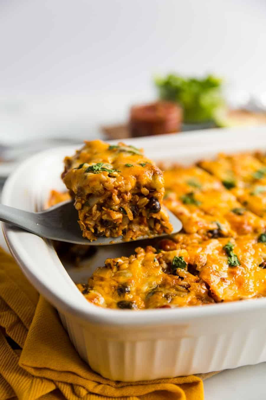 This easy, meatless meal is like a rice-and-bean-layered enchilada casserole. Topped with green or red enchilada sauce (you pick!) and cheese, you'll be satisfied with this savory rendition of a classic Tex-Mex dish.