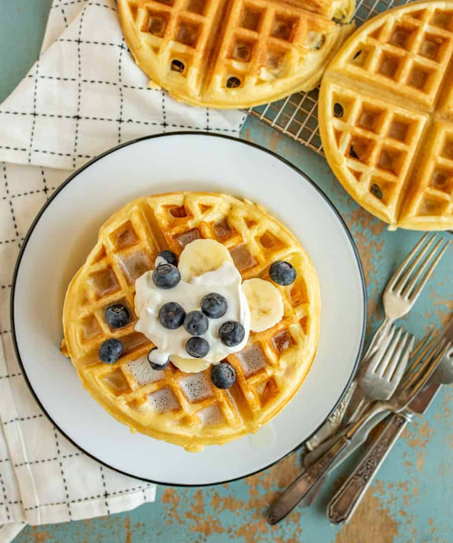Extra Light and Fluffy Belgian Waffle Recipe that are sure to be the best waffles you've ever had thanks to taking a few extra minutes to whip the egg whites before adding them to the batter.