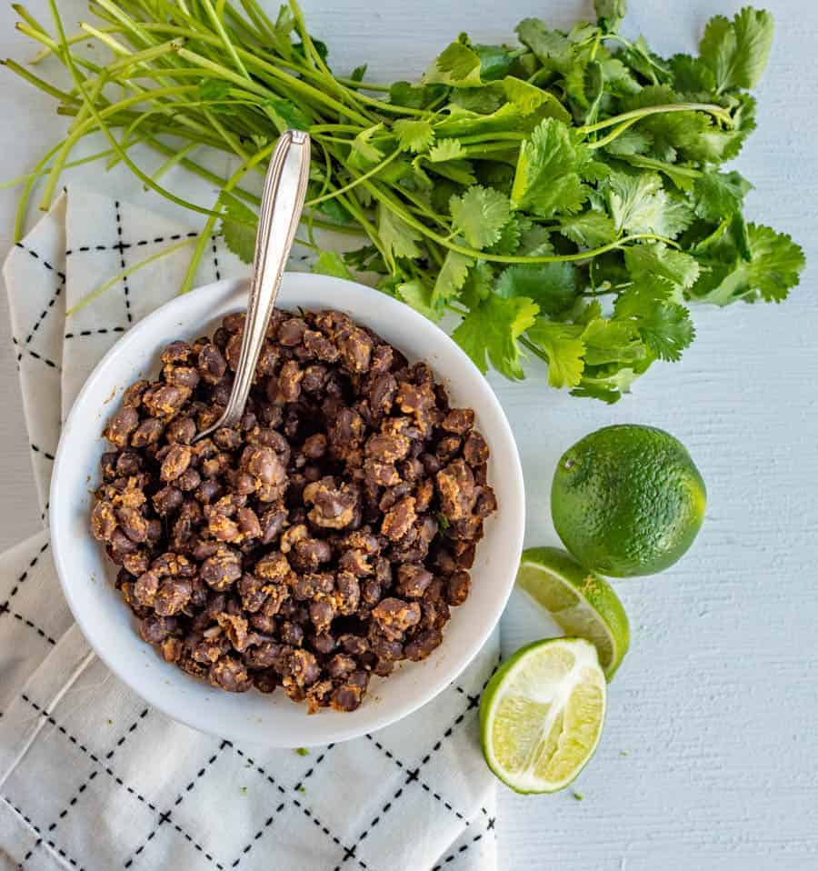 This Cafe Rio Black Beans recipe is a perfect side for taco night! Flavorful, salty, and slightly acidic, they fill out any meal and are the easiest to make!