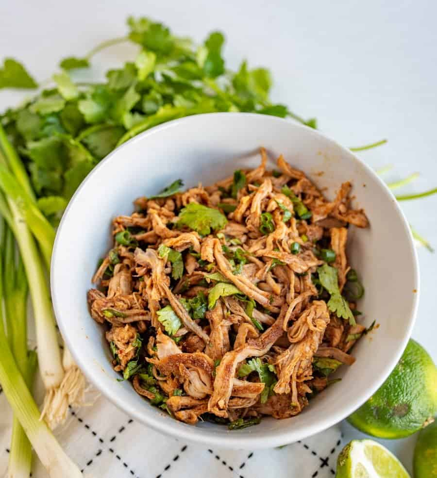 "This crockpot Cafe Rio sweet pork barbacoa recipe is a lifesaver for busy weeknights. I love a good ""toss it all in the slow cooker and forget about it 'til dinner time"" meal, don't you?"