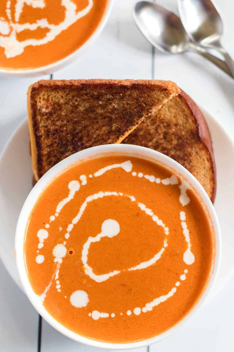 Simple Cream of Tomato Soup comes together quickly to make a creamy and lush soup with canned tomatoes, some onion and garlic, a little butter, and a few splashes of chicken broth and whole cream.
